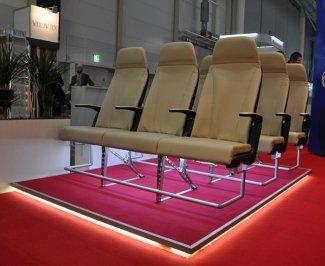 Trojsedadlo pro letadlo s 3D vytištěnými područkami