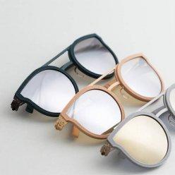 Stejný tvar slunečních brýlí v šedé, žluté a černé barvě obruby